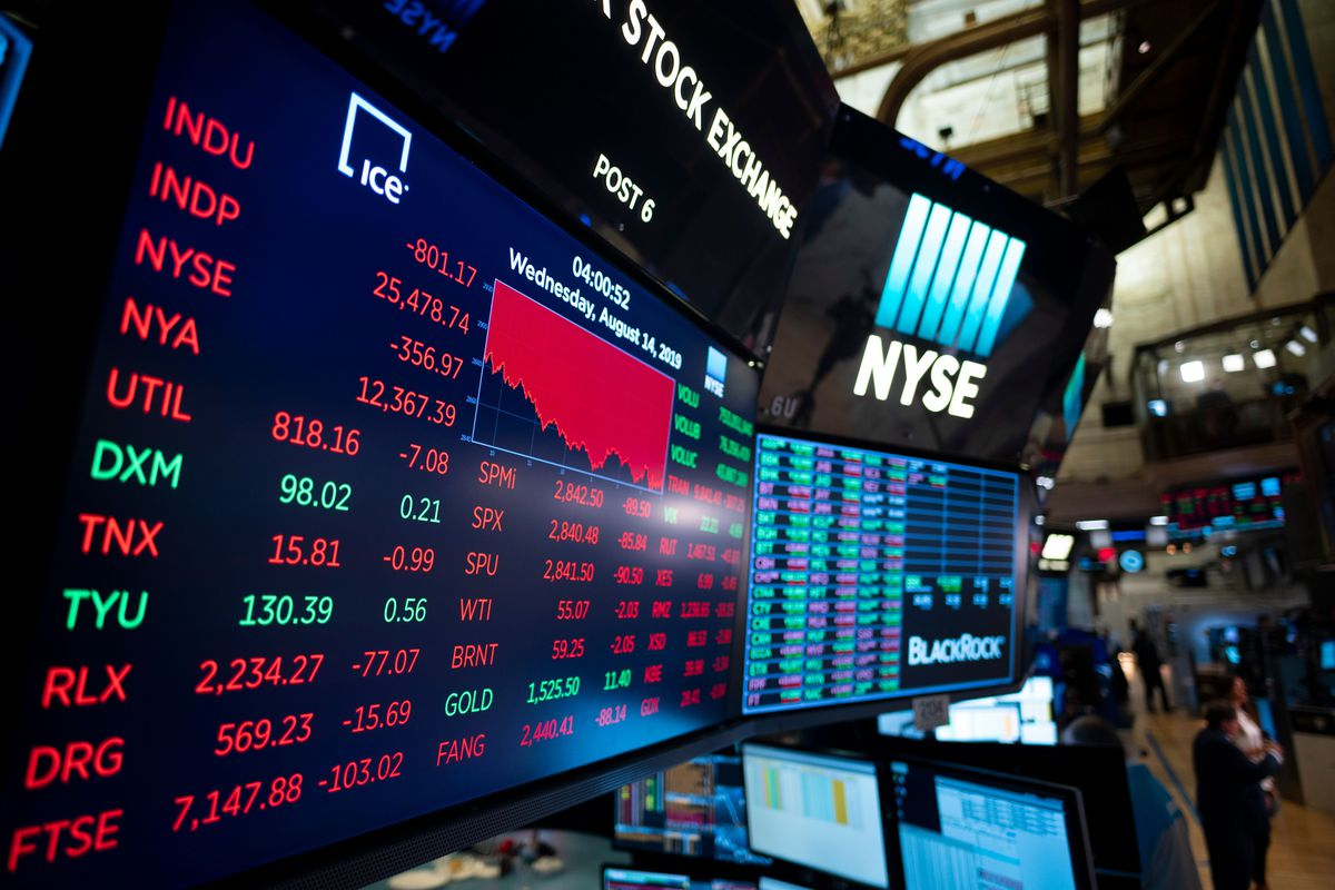 Signs at the New York Stock Exchange that have stock prices.