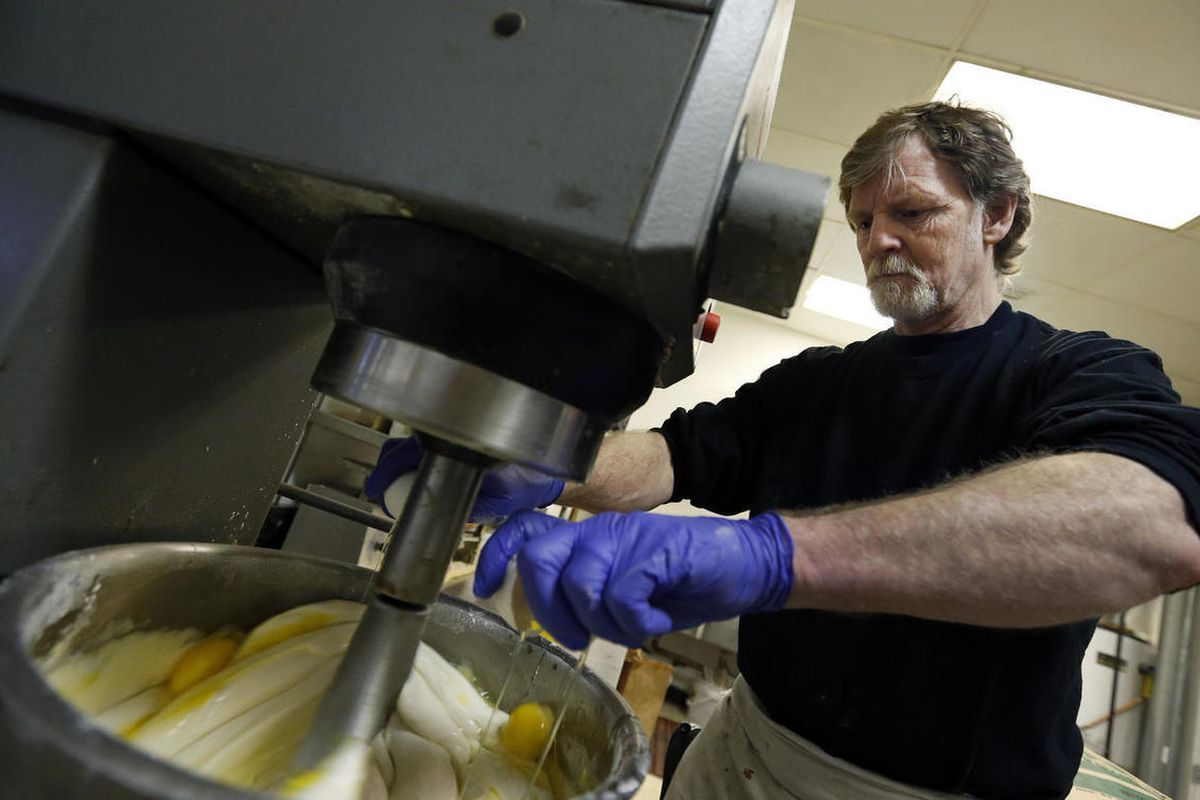 FILE - In this March 10, 2014 file photo, Masterpiece Cakeshop owner Jack Phillips cracks eggs into a cake batter mixer inside his store in Lakewood, Colo. The Supreme Court is taking on a new clash between gay rights and religion in a case about a weddin