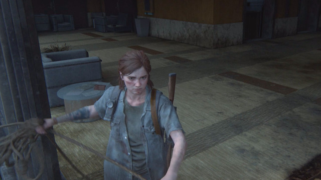 Ellie holding rope in The Last of Us 2.