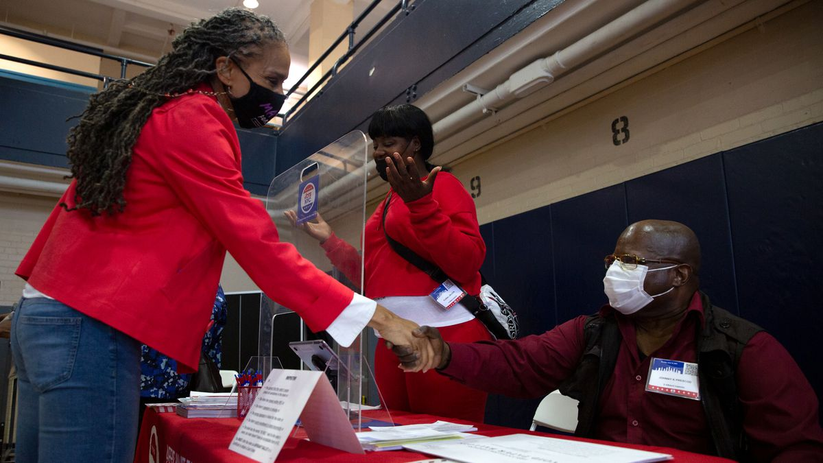Mayoral candidate Maya Wiley greets poll workers after voting early at the Erasmus Educational Campus in Brooklyn, June 14, 2021.