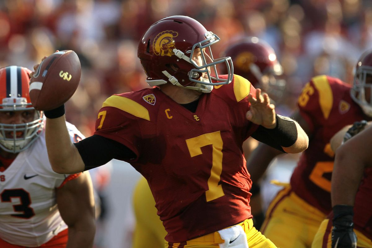 LOS ANGELES - SEPTEMBER 17:  Quarterback Matt Barkley #7 of the USC Trojans throws a pass against the Syracuse Orangemen at the Los Angeles Memorial Coliseum on September 17, 2011 in Los Angeles, California.  (Photo by Stephen Dunn/Getty Images)