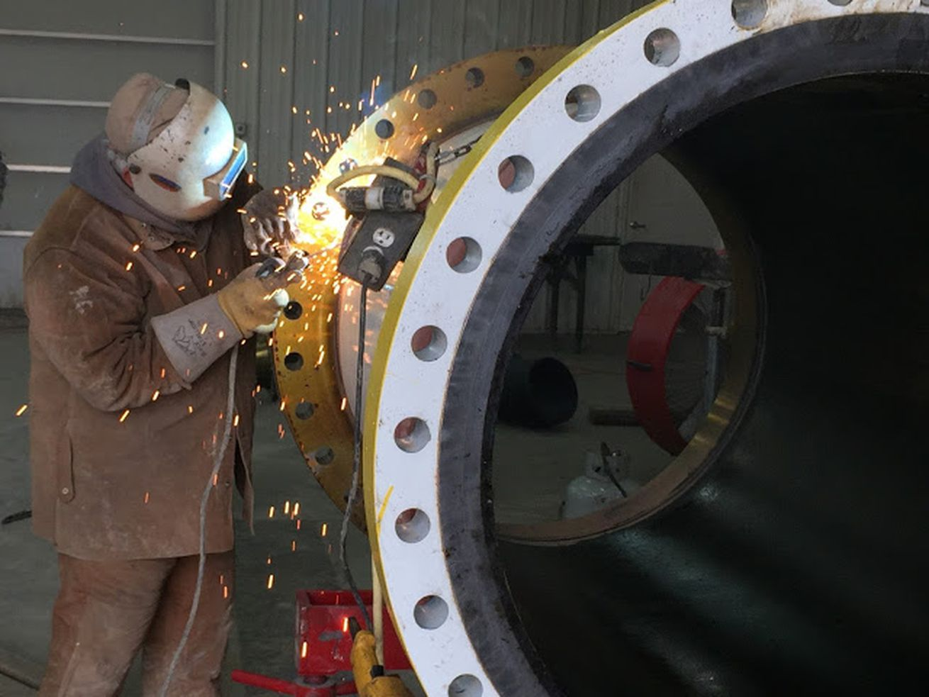 A worker from Folz Welding repairs an oil pipeline in Patoka, Illinois in 2016.