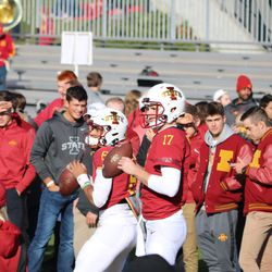 Kyle Kempt (17) is back in full uniform for the first time since September 8, 2018. Freshman Re-Al Mitchell (6) is warming up behind Kempt.
