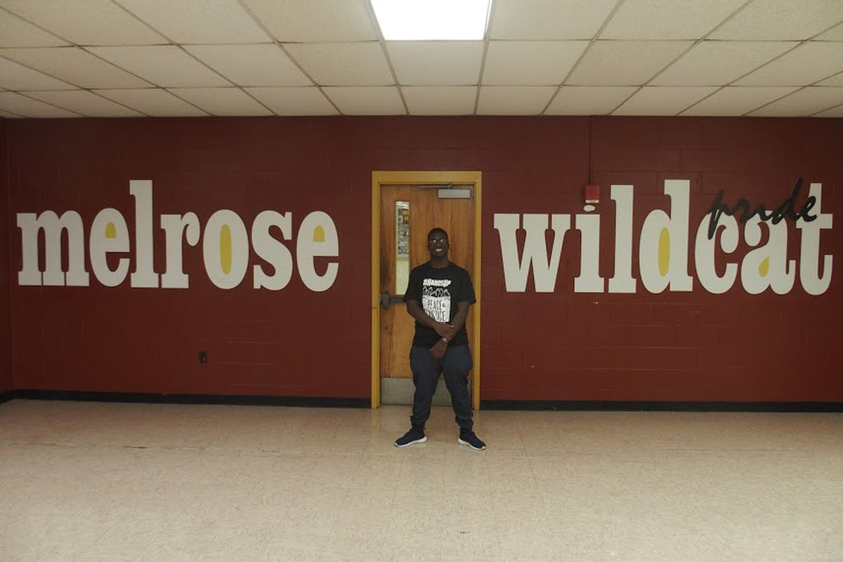 Stanford-bound student Dellarontay Readus stands in the hallway of Memphis Melrose High School during his senior year.