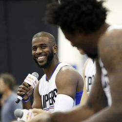 FILE - In this Sept. 26, 2016, file photo, Los Angeles Clippers' Chris Paul laughs as he, Blake Griffin and DeAndre Jordan, right, talk during the team's NBA basketball media day, in Playa Vista, Calif. The Houston Rockets have reached an agreement to trade for Los Angeles Clippers point guard Chris Paul according to a person familiar with the deal. The league source spoke to The Associated Press on Wednesday, June 28, 2017,  on the condition of anonymity because the team hasn't finalized the trade.