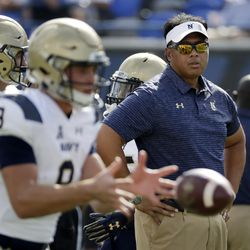 In this Oct. 14, 2017, file photo, Navy head coach Ken Niumatalolo watches as quarterback Zach Abey (9) warms up before an NCAA college football game against Memphis in Memphis, Tennessee.