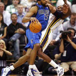 Dallas Mavericks guard Vince Carter (25) runs over Utah Jazz forward DeMarre Carroll (3) as the Utah Jazz and the Dallas Mavericks play Monday, April 16, 2012 in Salt Lake City.