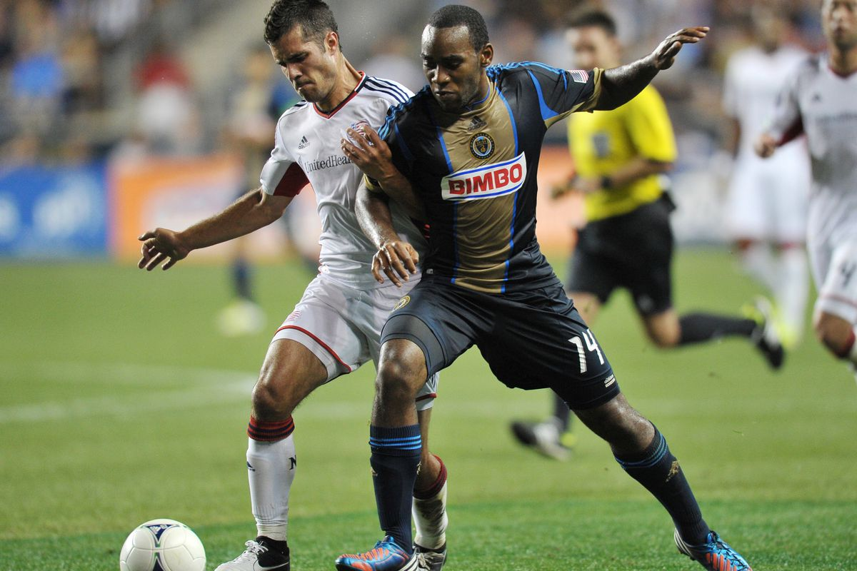 CHESTER, PA - JULY 29: Benny Feilhaber #22 of the New England Revolution and Amobi Okugo #14 of the Philadelphia Union fight for the ball at PPL Park on July 29, 2012 in Chester, Pennsylvania. The Union won 2-1. (Photo by Drew Hallowell/Getty Images)