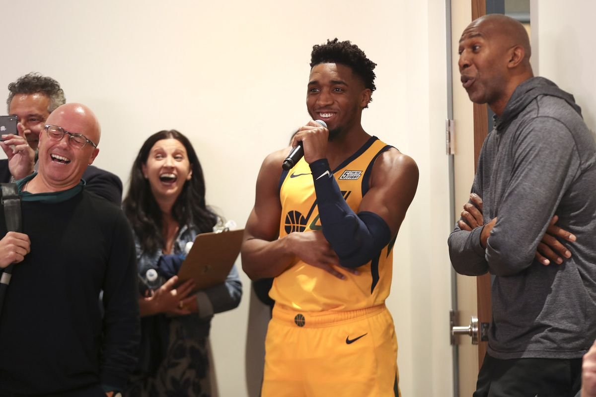 Members of the media laugh as Donovan Mitchell asks a question of new Jazz guard Mike Conley during Jazz Media Day at Vivint Arena in Salt Lake City on Monday, Sept. 30, 2019.