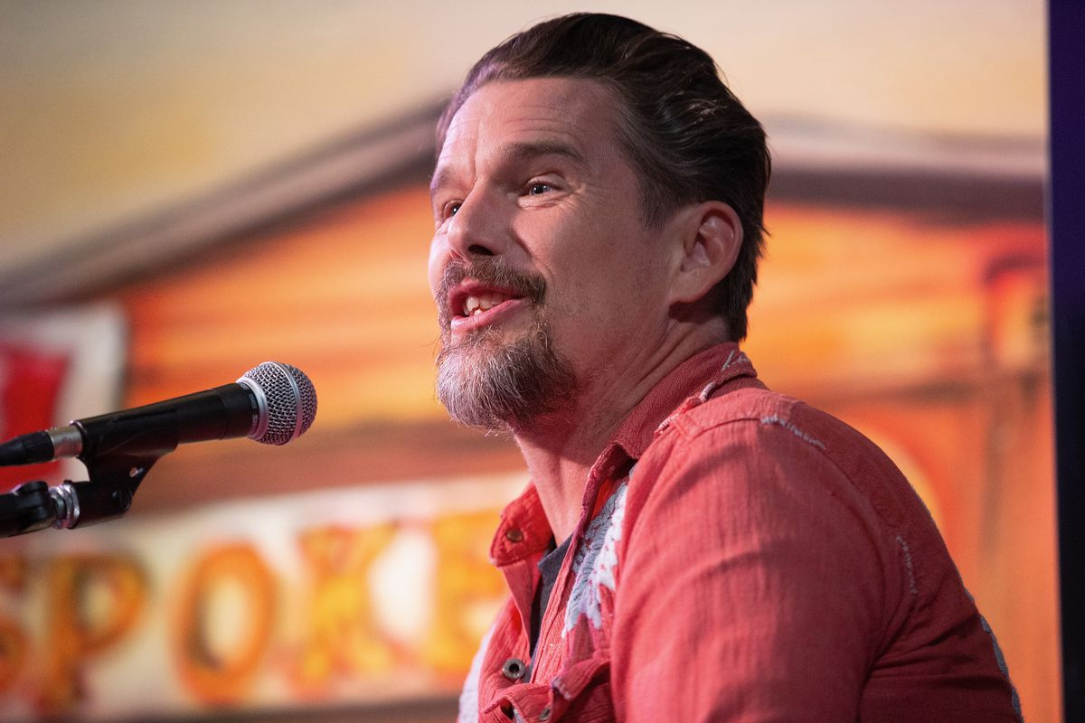 Ethan Hawke speaking into a microphone