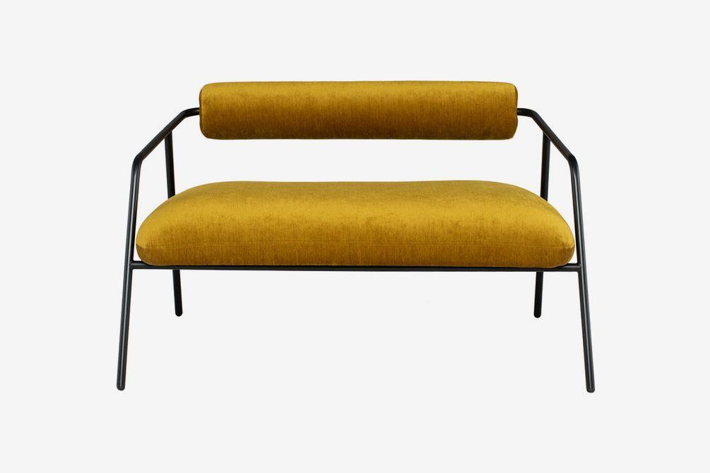 Golden sofa with black frame.