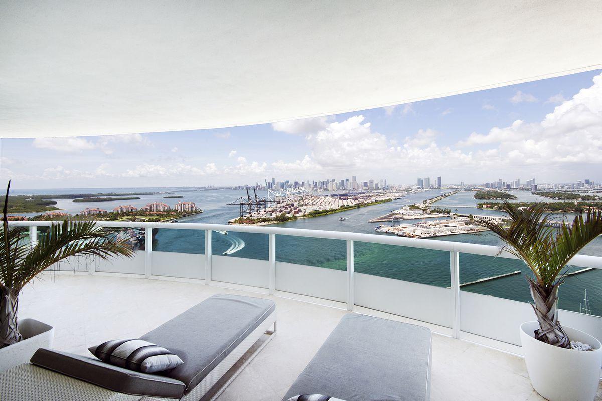 Unit 2601 at Murano Portofino in Miami Beach, showing a bay view off a white balcony