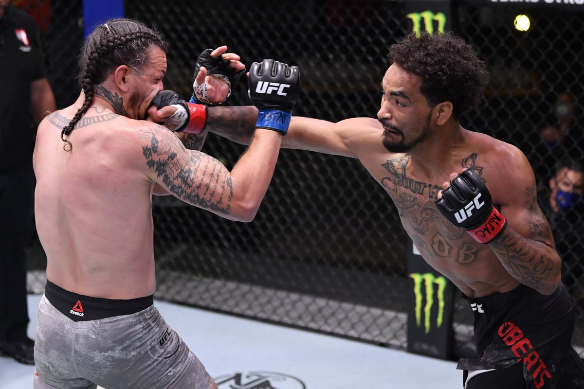 Roosevelt Roberts punches Brok Weaver in their lightweight fight during the UFC Fight Night event at UFC APEX on May 30, 2020 in Las Vegas, Nevada.