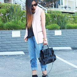 """Crystal of <a href=""""http://www.cryskay.com""""target=""""_blank"""">Cryskay</a> is wearing a <a href=""""http://www.zara.com/us/en/woman/shoes/high-heels/pointed-ankle-bootie-c269195p1294233.html""""target=""""_blank"""">Zara</a> top and shoes, a Mural vest, J Brand jeans, a"""