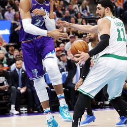 Utah Jazz center Rudy Gobert (27) tries to throw the ball off of Boston Celtics center Enes Kanter (11) as the Utah Jazz and the Boston Celtics play an NBA basketball game at Vivint Smart Home Arena in Salt Lake City on Wednesday, Feb. 26, 2020. Boston won 114-103.