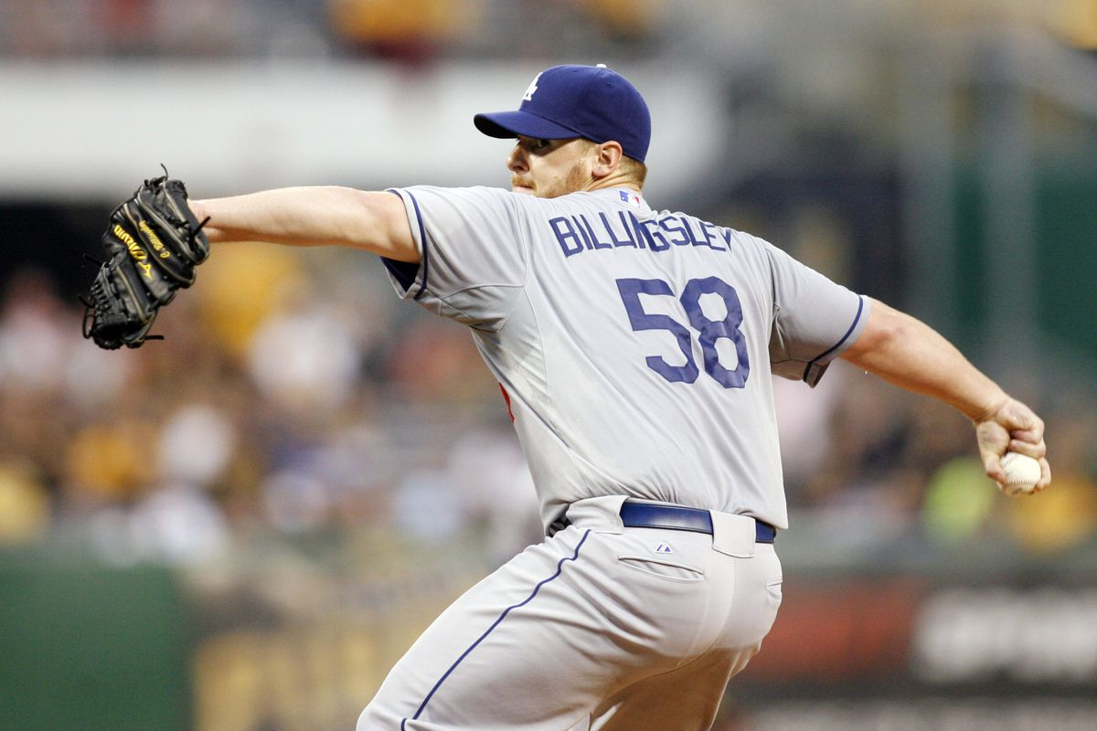 August 14, 2012; Pittsburgh, PA, USA; Los Angeles Dodgers starting pitcher Chad Billingsley (58) pitches against the Pittsburgh Pirates during the first inning at PNC Park. Mandatory Credit: Charles LeClaire-US PRESSWIRE