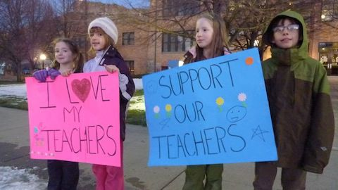 Two of Dougco parent Meredith Massar's daughters join friends in a protest outside the Douglas County Public Schools administration building.
