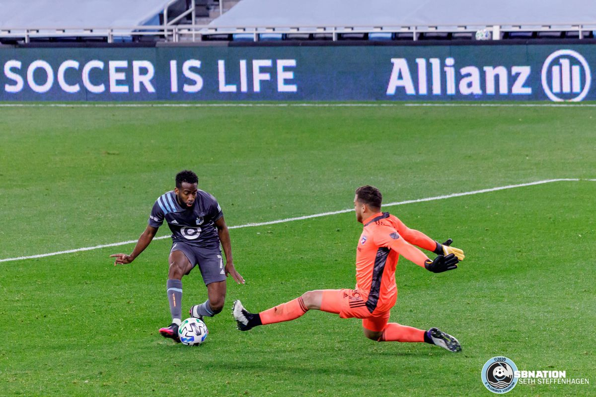 November 8, 2020 - Saint Paul, Minnesota, United States - Minnesota United midfielder Kevin Molino (7) takes a shot as FC Dallas goalkeeper Phelipe Megiolaro lunges out during the match at Allianz Field.