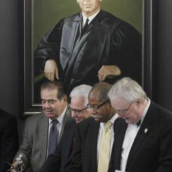 From left, Supreme Court Justice Antonin Scalia, Leonard F. Amari, President The John Marshall Law School Board of Trustees, Rory D. Smith, Associate Dean for Outreach and Planning at John Marshall, and John E. Corkery, Dean, The John Marshall law School, take part in a ribbon cutting during ceremonies naming a courtroom at The John Marshall Law School after former Supreme Court Justice Arthur J. Goldberg, who's portrait hangs behind them, Friday, Sept. 28, 2012  in Chicago.
