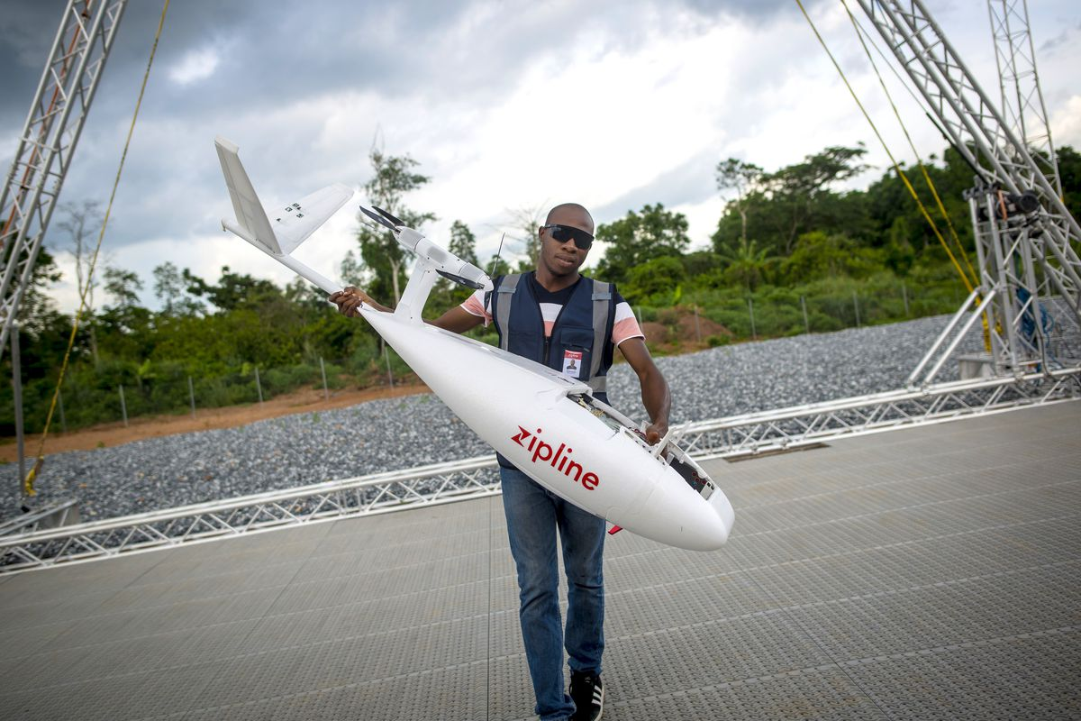 A staffer prepares to launch a Zipline drone at the Omenako distribution center in Ghana.