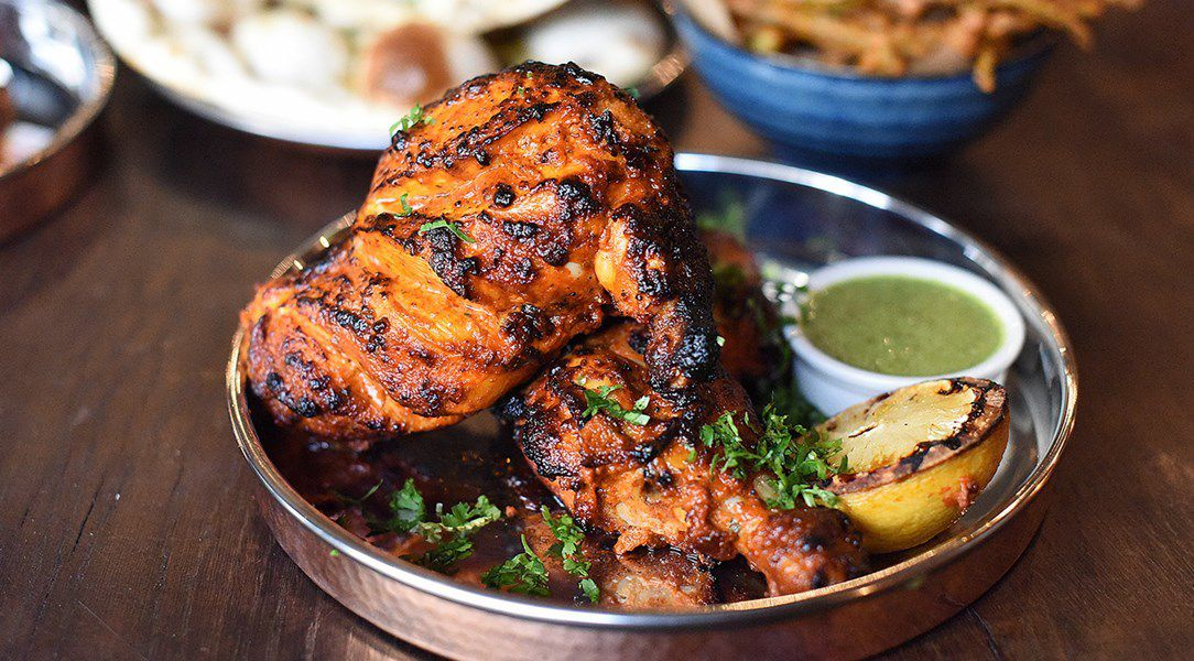 Chicken from the tandoor, served with lemon in a copper dish, at Tandoor Chophouse, one of the best north Indian restaurants in London