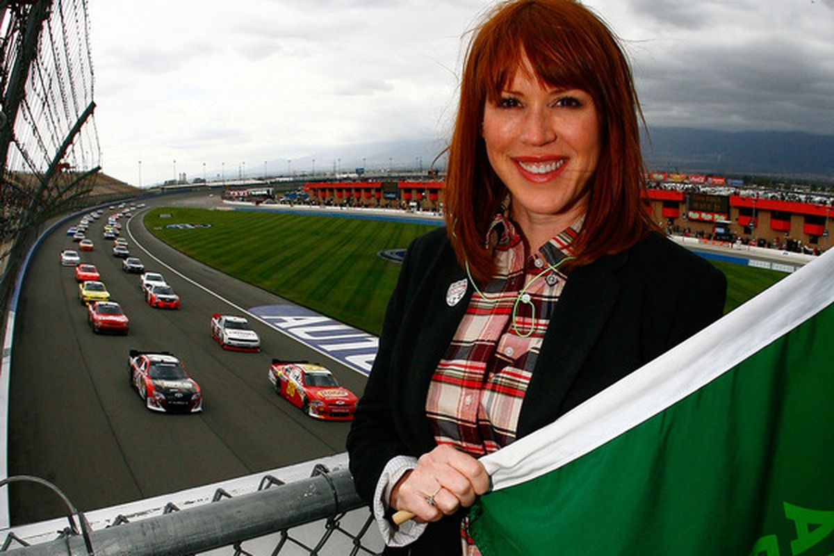 FONTANA, CA - MARCH 26:  Actress Molly Ringwald poses in the flagstand during the NASCAR Nationwide Series Royal Purple 300 at Auto Club Speedway on March 26, 2011 in Fontana, California.  (Photo by Jason Smith/Getty Images for NASCAR)