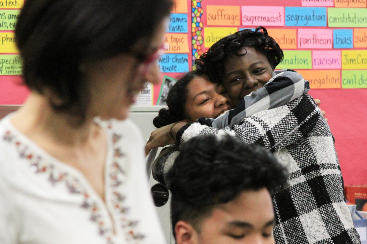 Kadijah Belcher (right), hugs her friend after finding out she was admitted into LaGuardia High School.