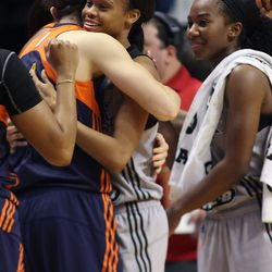 Connecticut Sun's Kelly Faris (34) and San Antonio Stars' Moriah Jefferson (4) embrace after the game. The pair won a national championship at UConn in Faris' senior year.
