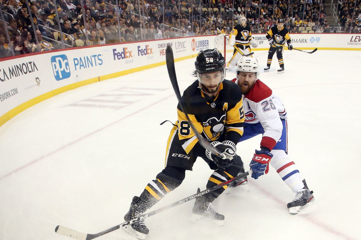 Pittsburgh Penguins defenseman Kris Letang chases the puck against Montreal Canadiens defenseman Jeff Petry during the third period at PPG PAINTS Arena. Pittsburgh won 4-1.