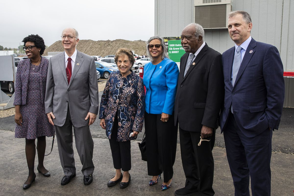 (From left) Illinois Democratic U.S. Reps. Lauren Underwood, Bill Foster, Jan Schakowsky, Robin Kelly, Danny Davis and Sean Casten pose for a photo shorty before President Joe Biden is scheduled to visit and discuss COVID-19 vaccine requirements at a Clayco, Inc. construction site in Elk Grove Village, Thursday, Oct. 7, 2021.