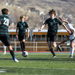 Farmington striker Spencer Wall (19) charges down the field during the game against Olympus at Farmington High School on Thursday, March 18, 2021.