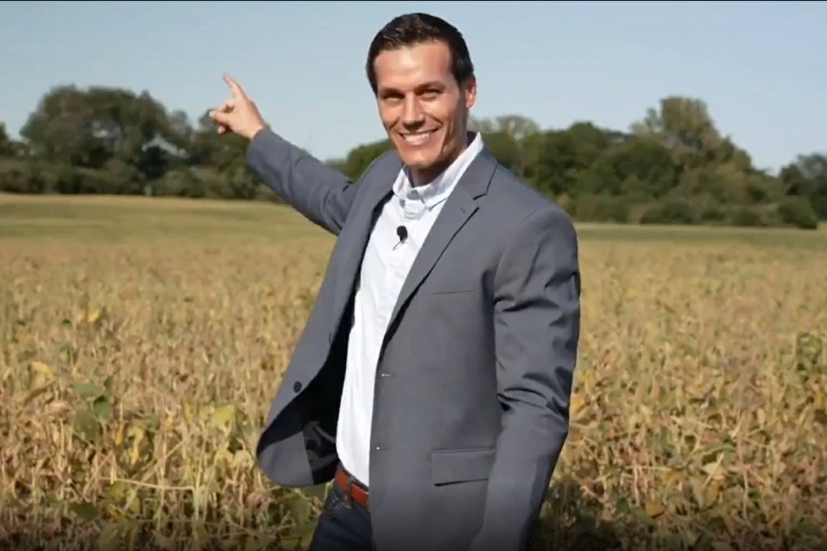 Republican candidate for governor Jesse Sullivan stands in a soybean field and points to his home in Petersburg, Illinois, in a campaign video.