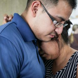Juan Alvarez consoles his wife Susie, the two moved to South Ogden from Merced, California, three weeks ago, at the Dee Events Center in South Ogden on Tuesday, Sept. 5, 2017.
