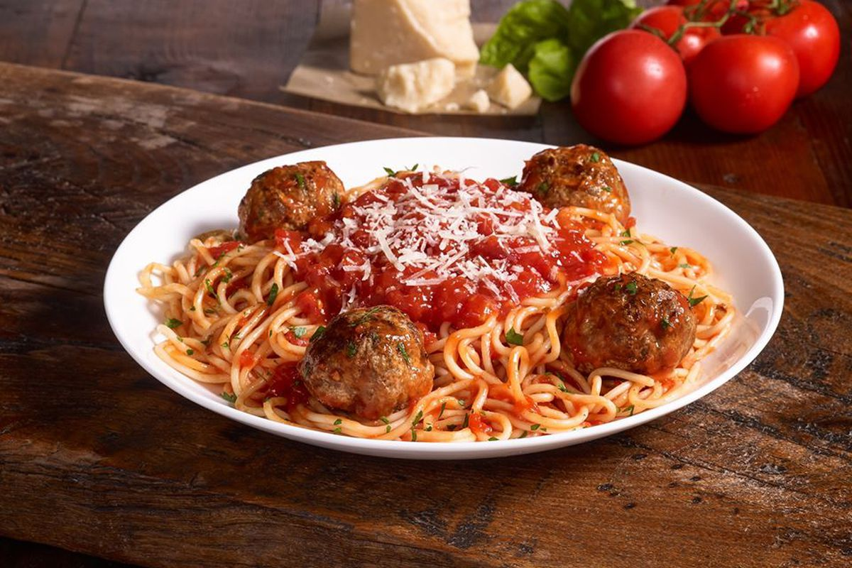A bowl of spaghetti and four meatballs at Paolino in Oakhurst Decatur, Georgia