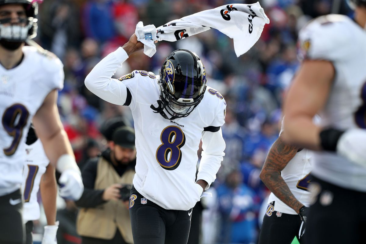 Lamar Jackson of the Baltimore Ravens waves a towel around before an NFL game against the Buffalo Bills at New Era Field on December 08, 2019 in Orchard Park, New York.