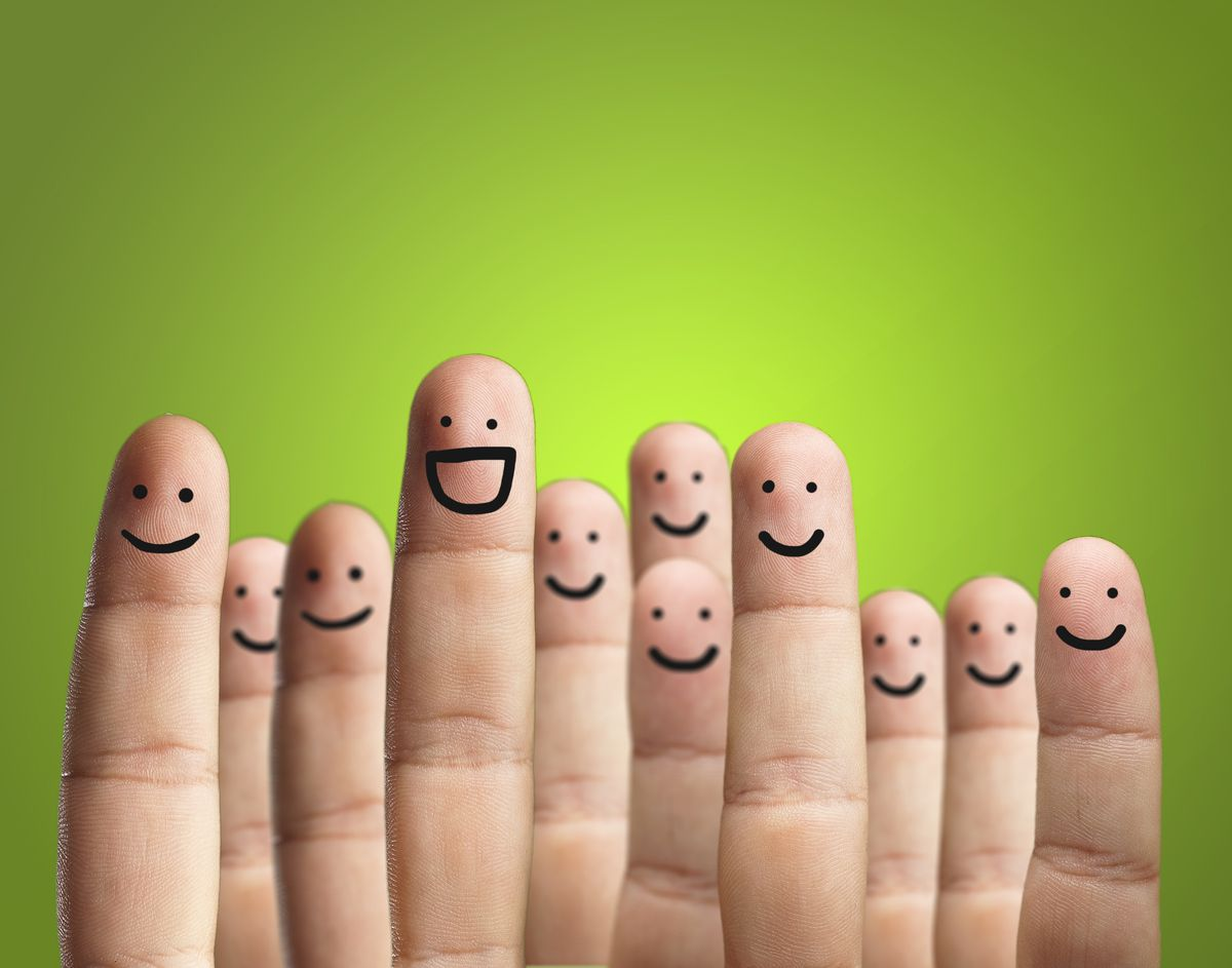 Fingers with marker happy faces