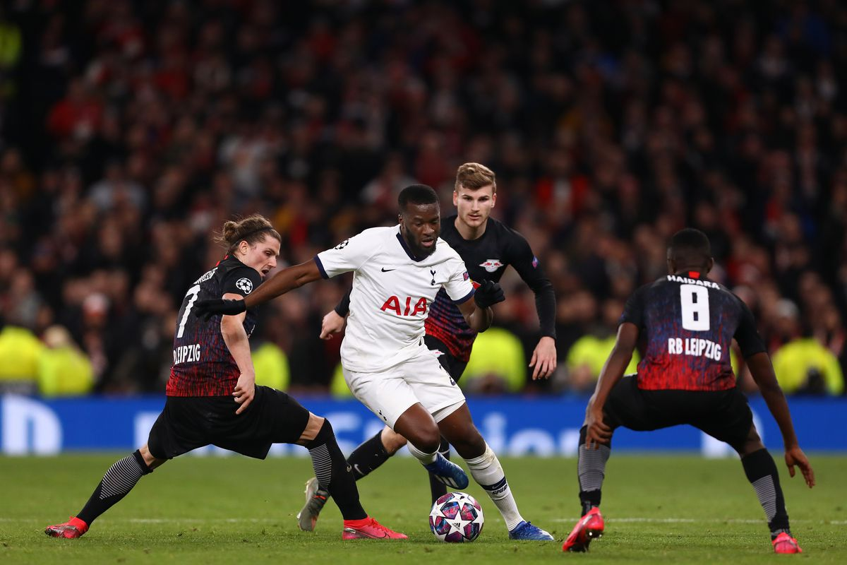 Tanguy Ndombele of Tottenham Hotspur in action with Marcel...