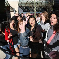 People wait for the opening of the new City Creek Center Thursday, March 22, 2012.