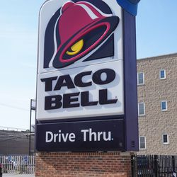 A closeup of the Taco Bell sign, with the Cubs cap