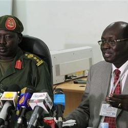 South Sudanese Minister of Information Barnaba Benjamin Marial, right, and Military Spokesman Philip Aguer brief the media on Tuesday, March 27, 2012 in Juba, south Sudan about recent fighting between Sudanese and South Sudanese forces along the north-south border. The fighting has prompted Sudanese President Omar al Bashir to cancel his trip to Juba on April 3, derailing recent momentum in negotiations between the two countries. (AP Photo/Michael Onyiego)