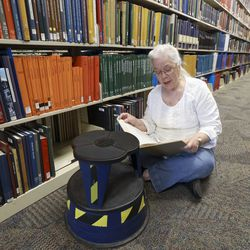 Rose Mary Pearson is researching books on her family history in North Carolina at the Family History Library at The Church of Jesus Christ of Latter-day Saints in Salt Lake City on Tuesday, July 6, 2021. The library reopened after being closed for 16 months.