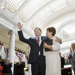 Gov. Gary Herbert and his wife, Jeanette, greet the crowd after Herbert took the oath of office from Utah Supreme Court Chief Justice Christine Durham, right.