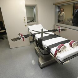 In this Oct. 9, 2014, file photo, Department of Corrections officials are pictured in the witness room at right, outside the newly renovated death chamber at the Oklahoma State Penitentiary in McAlester, Okla. With executions in Oklahoma on hold amid a constitutional review of its lethal injection formula, Republican legislators are pushing to make Oklahoma the first state in the nation to allow the use of nitrogen gas to execute death row inmates.