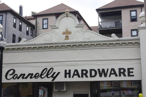 The top of a storefront, with the words Connelly Hardware written out in big, clear letters.