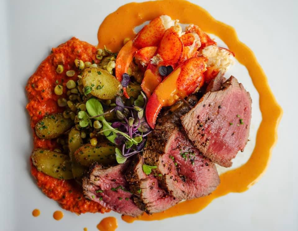 8oz of beef, lobster knuckle claw meat, roasted fingerling potatoes and corn, Romesco and sherry cream sauce