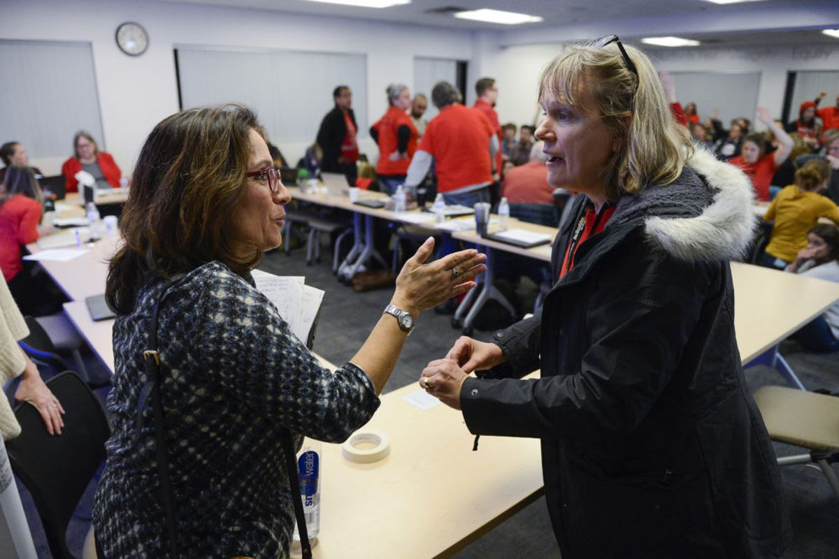Denver Superintendent Susana Cordova, left, talks with Denver Green School English language acquisition teacher Paula Zendle during a break in negotiations between the district and the union.