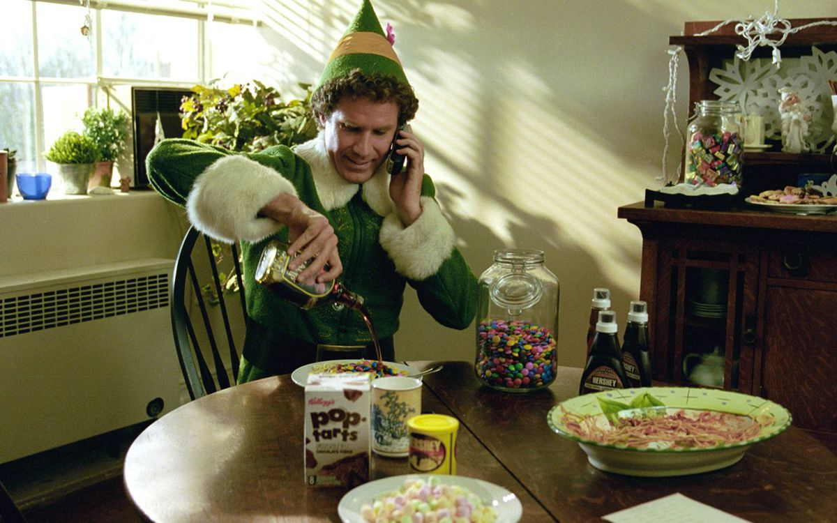 will ferrell as buddy in elf, pouring syrup on pancakes while on the phone