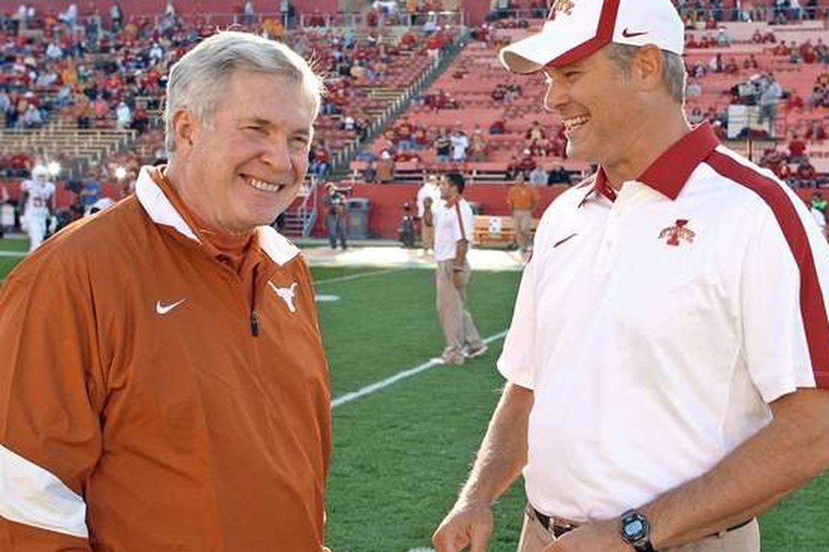 <em>Mack Brown and Paul Rhoads pregame negotiating the number of penalties and turnovers the Cyclones would gift the Longhorns.  Part of the new Big 12 Tier 1 rights distribution model. (The Des Moines Register)</em>