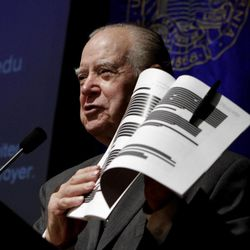Retired California Supreme Court Justice Cruz Reynoso, who led a 13 member task force looking into the pepper spraying incident that occurred at the University of California, Davis last November, holds up an early copy of the report  during a town hall style meeting held at the campus in Davis, Calif., Wednesday,  April 11, 2012.  The report  was originally set for release March 6, but lawyers for the law enforcement officers involved wanted more than 60 percent of the document blacked out claiming it contained personnel records that should not be publicly released under state law.  The final report was released with much of the information reinstated but without the names of most of the officers involved in the clash.