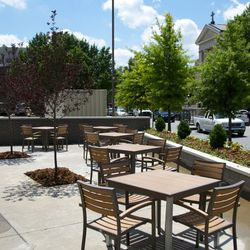The back patio seating overlooks Baxter Avenue.